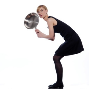 woman holding a frying pan
